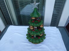 Lit Christmas tree with chiming bells