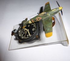 Junghans German cockpit cloth / Borduhr / Blindflieguhr - WW2. with stand and model of the fighter aircraft in which it was used