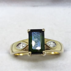 Vintage natural Ceylonese moss green emerald cut tourmaline and diamonds in yellow gold.
