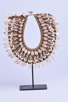 Necklace of shells on stand - IATMUL - Papua New Guinea