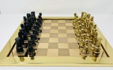 Jewellery chess of 24k gold with box made of carved wood