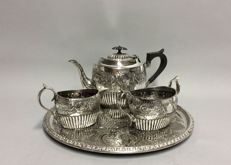 Antique silver plated tea set, on a serving tray, England, ca. 1890