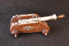 A silver canon with accessories on wood affuit - Portugal - circa 1930