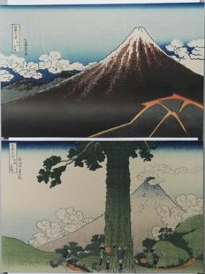 "Two woodblock prints by Katsushika Hokusai (1760-1849) (reprints) - 'Rainstorm Beneath the Summit' and 'Mishima Pass in Kai Province' from the series ""Thirty-six Views of Mount Fuji"" - Japan - 2nd half 20th century"