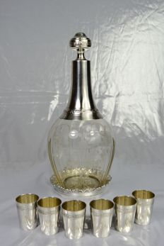 Cut crystal liquor decanter, coaster for decanter and six silver cups, France, circa 1900