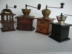 Four lap coffee grinders, including an exclusive transparent model and a very large one made of wood and copper, ca. 1920 to 1945. They come from France and Germany