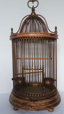 Antique bird cage with wood and a lot of copper