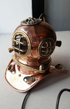 Lamp.Small copy of an old underwater helmet of copper height 18cm.