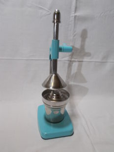 A vintage chrome metal citrus press juicer.