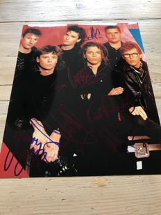 INXS signed photograph including signature of Michael Hutchence