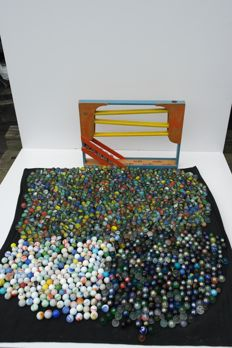 """Wooden marble run (brand: Homas) and unique glass marbles, including """"cat's eyes"""""""