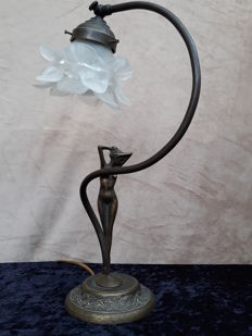 Art Nouveau bronze desk lamp, the shaft in the shape of a standing female nude and the glass flower calyx