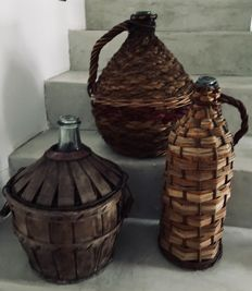 3 demijohn bottles in blown glass and wicker
