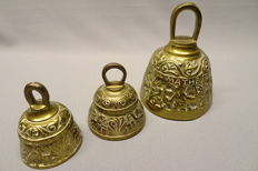 Three bronze bells of which two - early 20th century