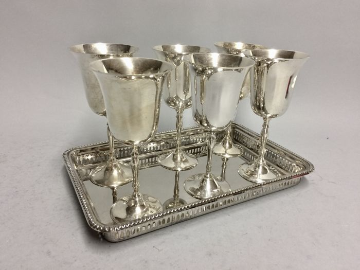 Six silver plated wine goblets on a silver plated presenting tray, England, ca 1955