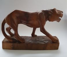 Statuette of a panther carved from wood