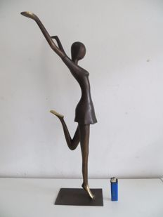 Large bronze sculpture of a cheerful dancer