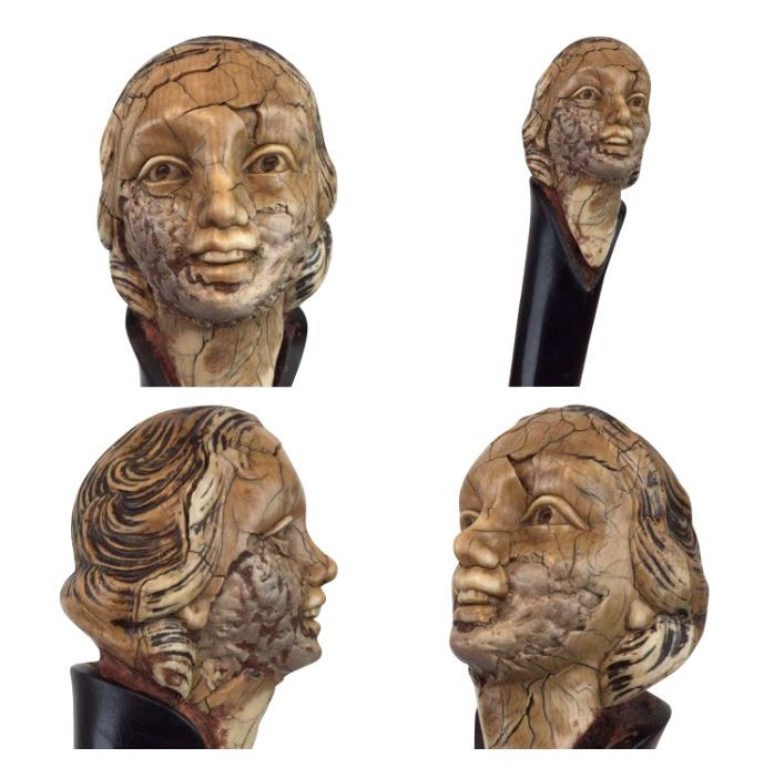 A dark wooden walking stick with carved ivory woman's head in Art Deco hairstyle - ca. 1920