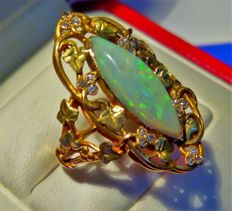 18 ct. yellow gold French Art Nouveau ring , set with a lozenge- shaped ca. 2.10 ct. Opal and 18 diamonds ca. 0.23 ct., No Reserve