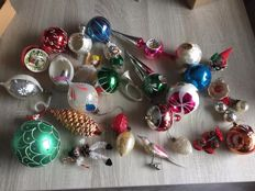 Old Christmas baubles (decorations) and tree topper