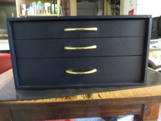 Christofle cutlery cabinet with three drawers.