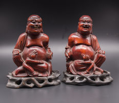 A pair of laughing Buddha wood carvings - China - mid 20th century