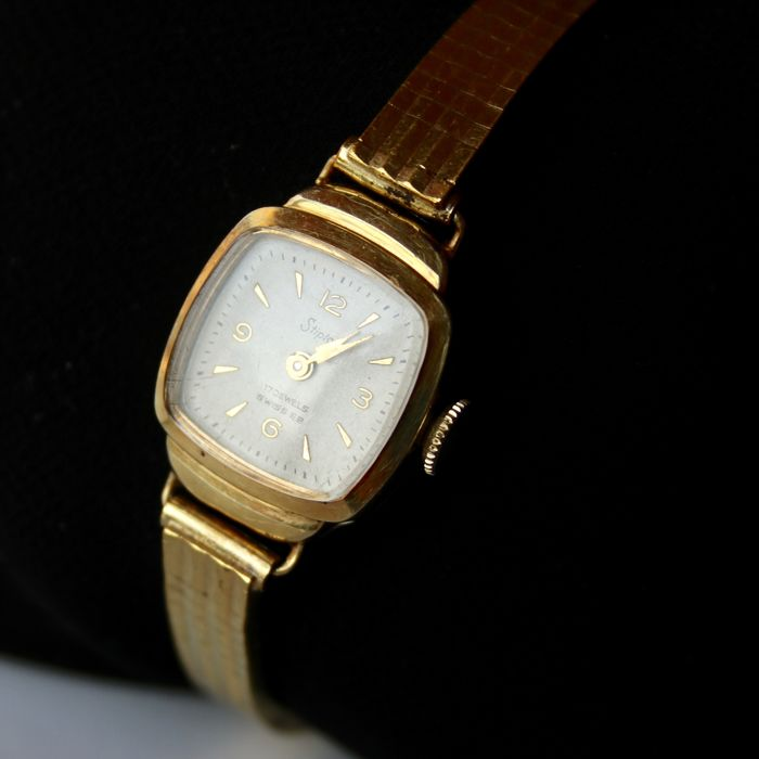 Vintage Swiss horloge about 1960 partly 14kt solid gold and goldplated  in good functioned state.