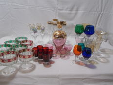 A variety of 39 pieces of colorful feet glasses, vintage.