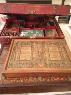 Several old games: An antique suitcase (Jeux Reunis, Jacques Gilain) full of La Colombeo, Le moulin jolie, le Pont Fatal, L'intraitable and clock-and hammer game-stone building kit Richter's (Anchor blocks) and wooden blocks box
