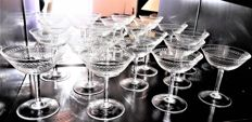 Old set of 11 refined crystal champagne glasses, richly hand engraved.