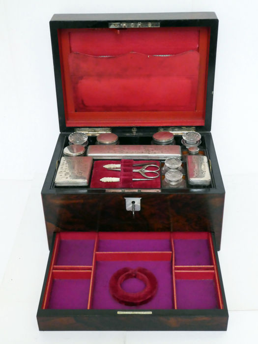 A rosewood vanity box with fitted interior, bottles and hidden jewelery drawer, England, ca. 1880
