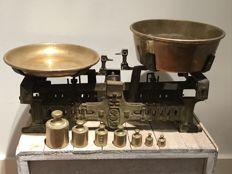 Cast-iron scale with brass scales includes markings and matching weights - c.  1900