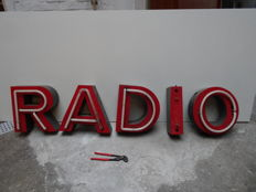 Sheet iron neon letters.  RADIO ca 1950