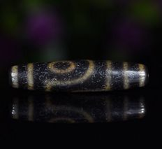 Antique two-eye agate Dzi from Tibet - 53 x 12 mm