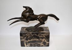 Abstract bronze horse of bronze on a marble pedestal