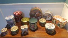Beautiful collection of 12 Christmas tins, 1 of which a music box