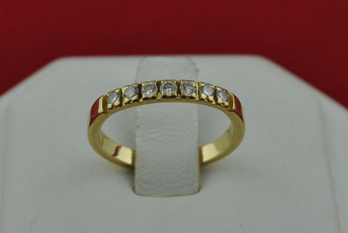 7 Diamonds (Total +/-0.21CT) set on 18k Yellow Gold, E.U Ring Size:  48  (Re-sizable)