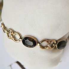 circa 1910/1920 Art Nouveau silver and gold handcrafted bracelet with 5 facetted oval cut Smoky Quartz approx. 10.90 ct. total in leaf design with safety chain.