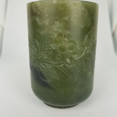 A hand carved serpentine cup - China - late 20th century