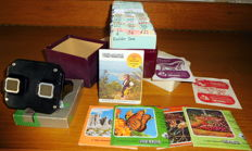 Lot of 128 view-master discs, collection box, viewer in box + reel list 1959