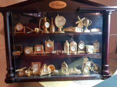 Collection of 28 Le Temps miniature clocks