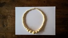 Necklace made up of balls in ivory - from the former Belgian Congo