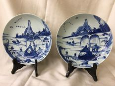 Two deep dishes with a painting allover, a pagode and people - China - 19th century