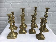 Nice collection of eight antique, copper candle holders, England, 1850/1880