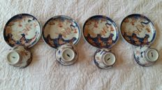 Imari porcelain cups with accompanying saucers - Japan - 18th century