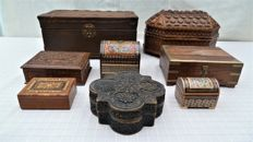 Lot of eight wooden ornamental boxes, carved, brass, and leather