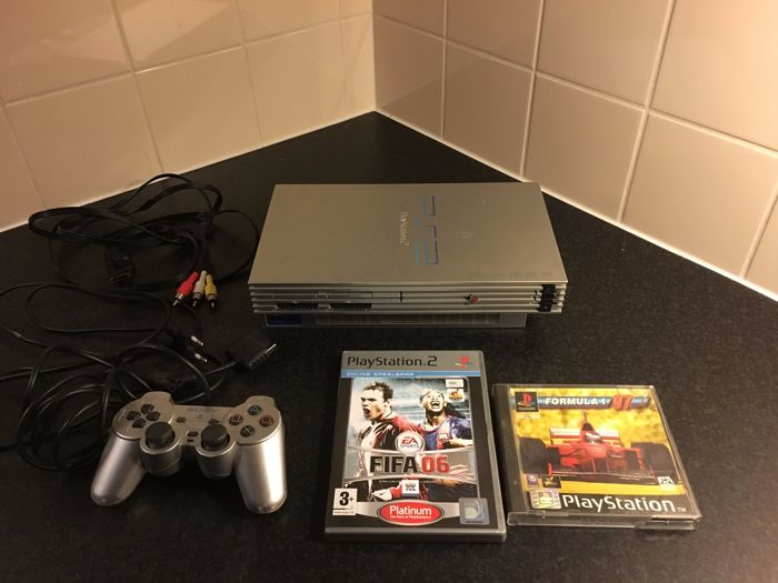 Sony PlayStation 2 (PS2) Silver Edition, 1 controller, 9 games