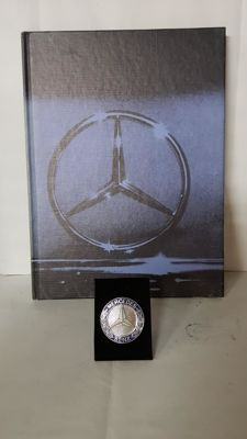 Mercedes book and badge