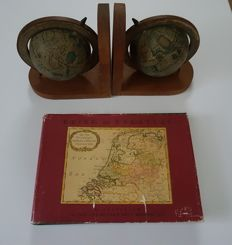Globe bookends and a travel and pocket atlas
