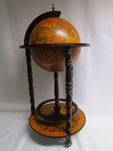 A wooden globe/ bar - with a detailed map - Neptune
